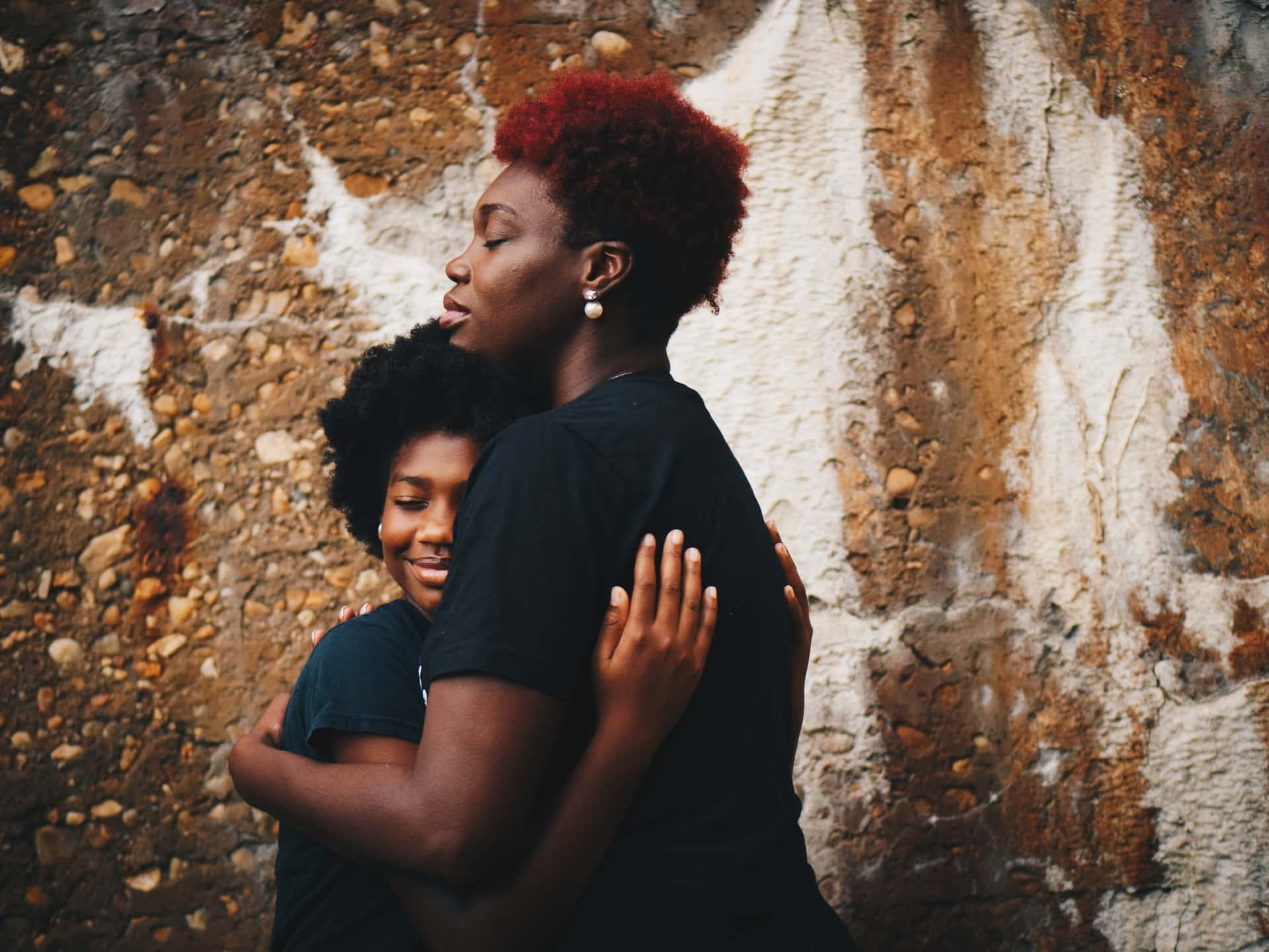 Mother and daughter hugging with eyes closed for article titled What Is Life Insurance