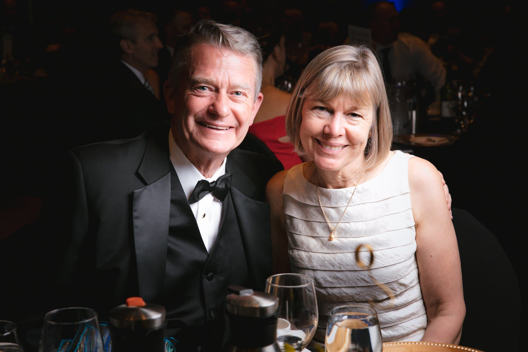 Photo of 2 well-dressed people from a FUNDSY Gala event