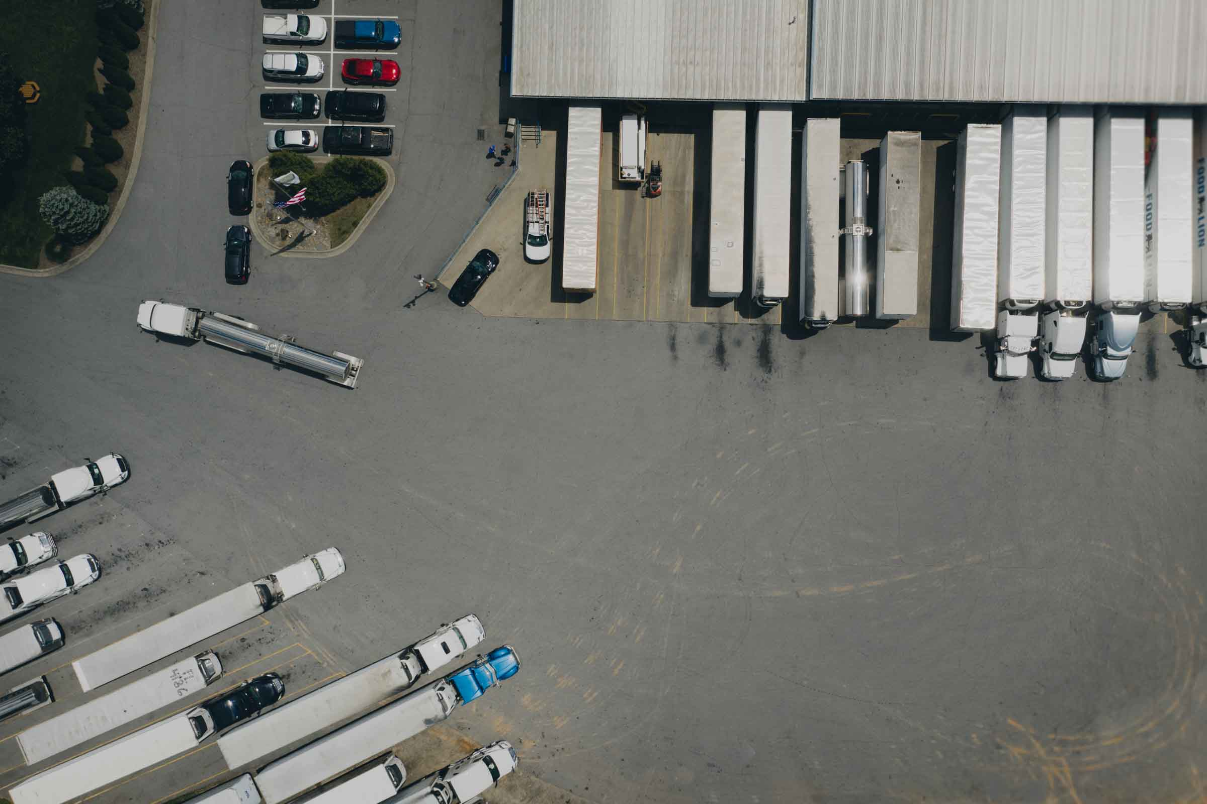 Arcadia's parking lot with lots of trucks dropping off and delivering products illustrating a single source supply chain