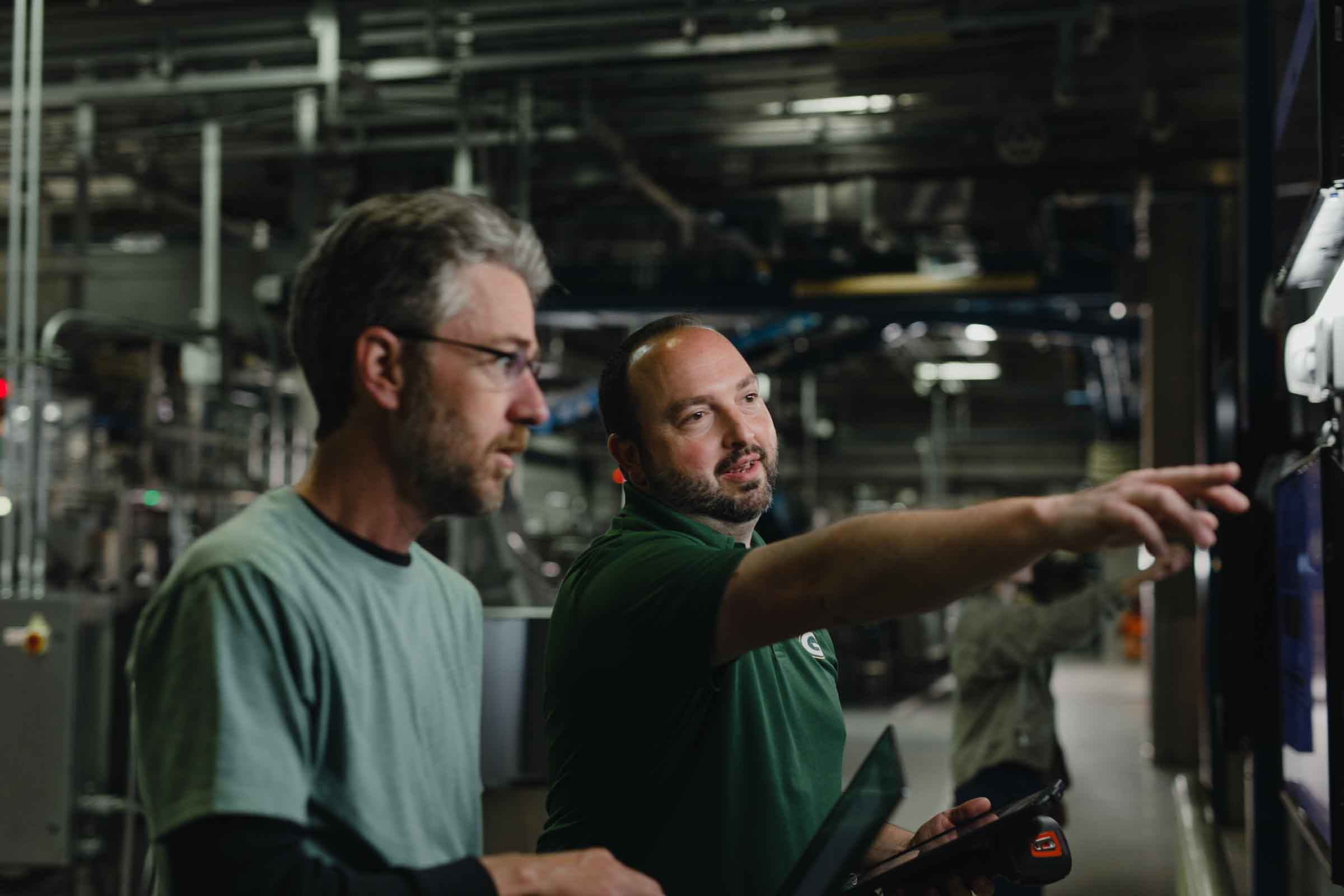 Two team members at Arcadia working with our Single source supply chain