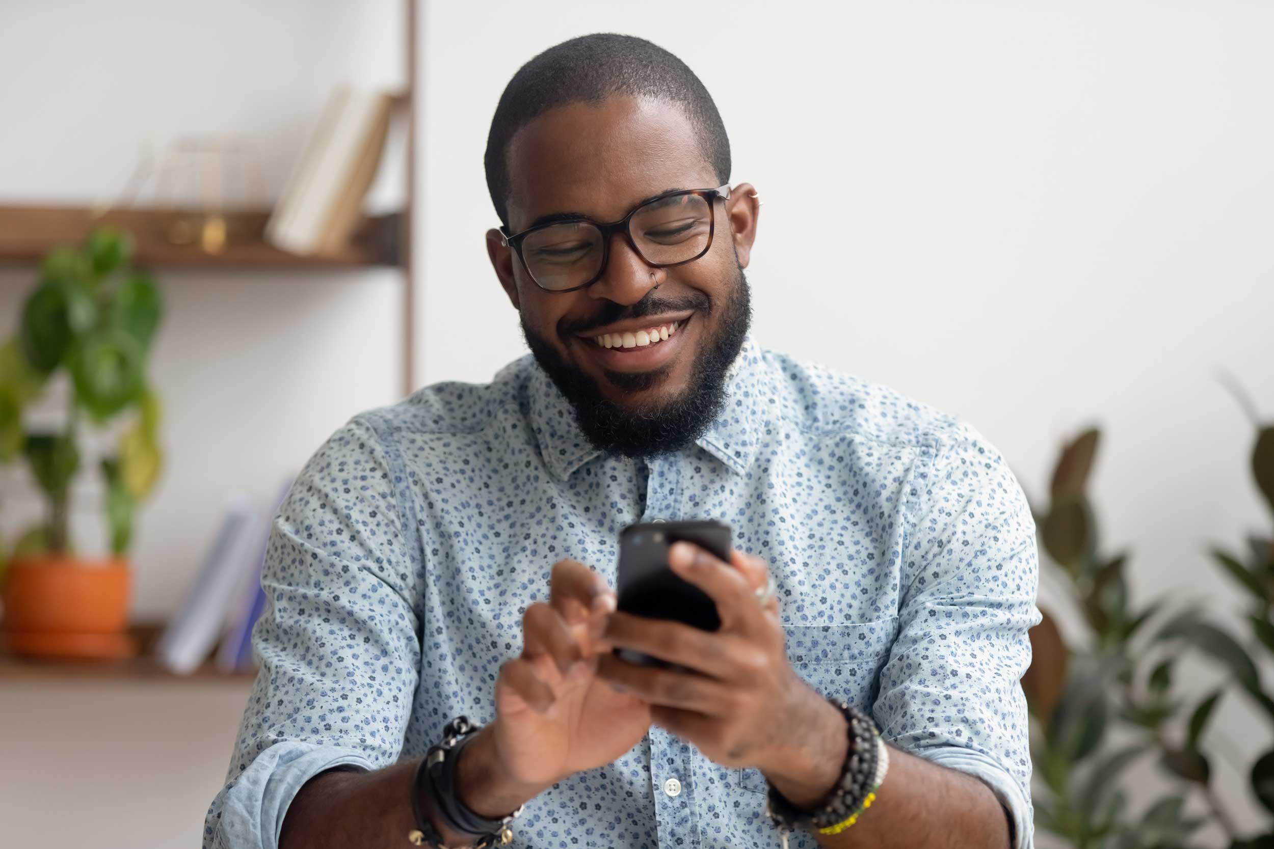 happy business man using his mobile to shop online
