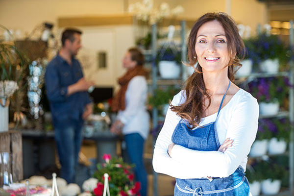 A female business owner standing in her flower shop.
