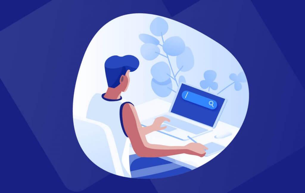 Eine Programmiererin, die an einem Laptop sitzt und arbeitet.