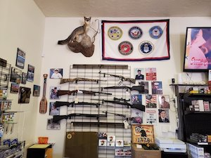 Interior image of Council Guns store showing firearms for sale.