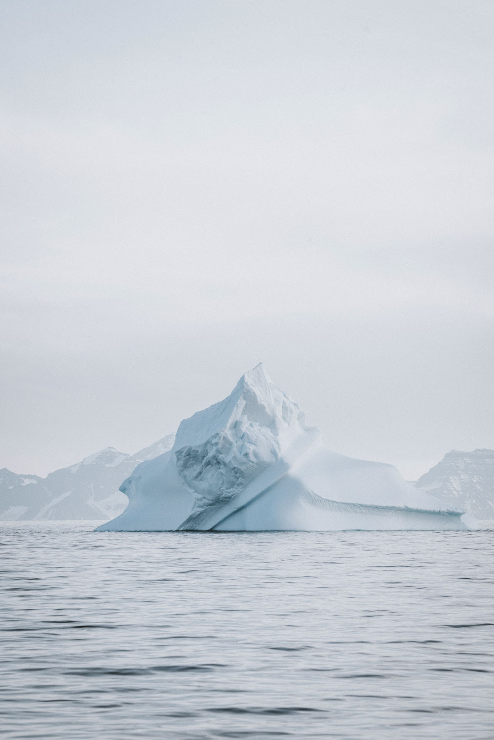 Iceberg surrounded by the sea