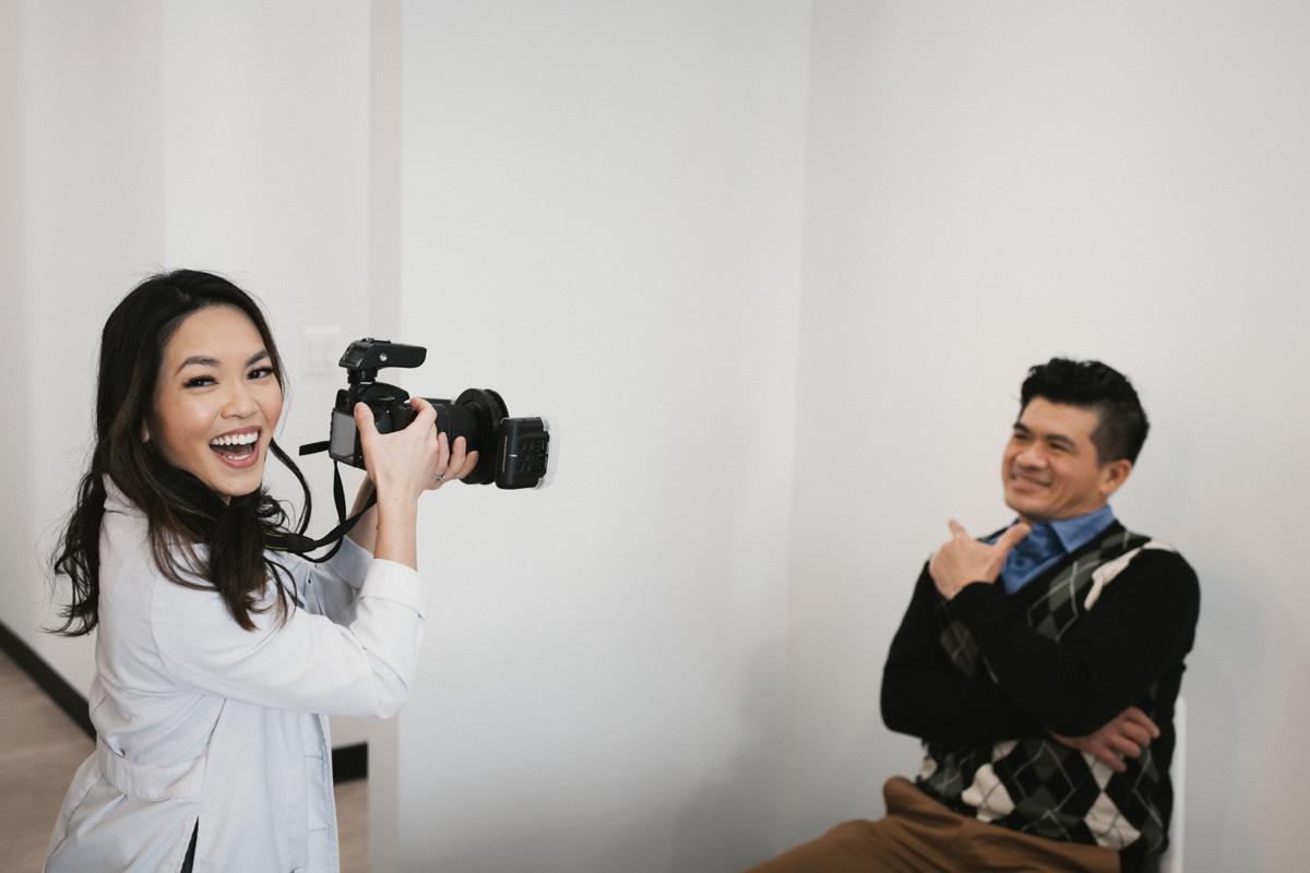 Photo of Dr. Bella taking a picture of a patient