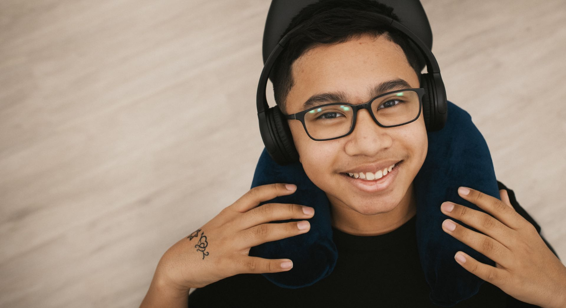 Photo of a patient smiling with headphones on
