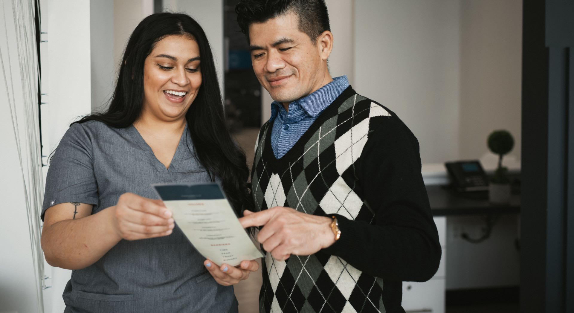 Photo of a Carabella team member with a patient reviewing information