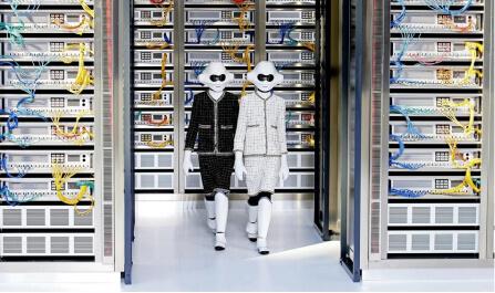 two person walking next to servers