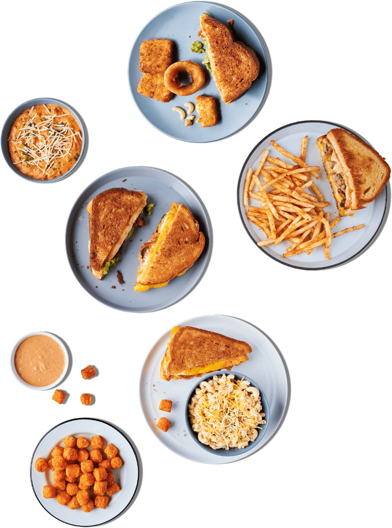 A spread of Grilled Cheese Society menu items