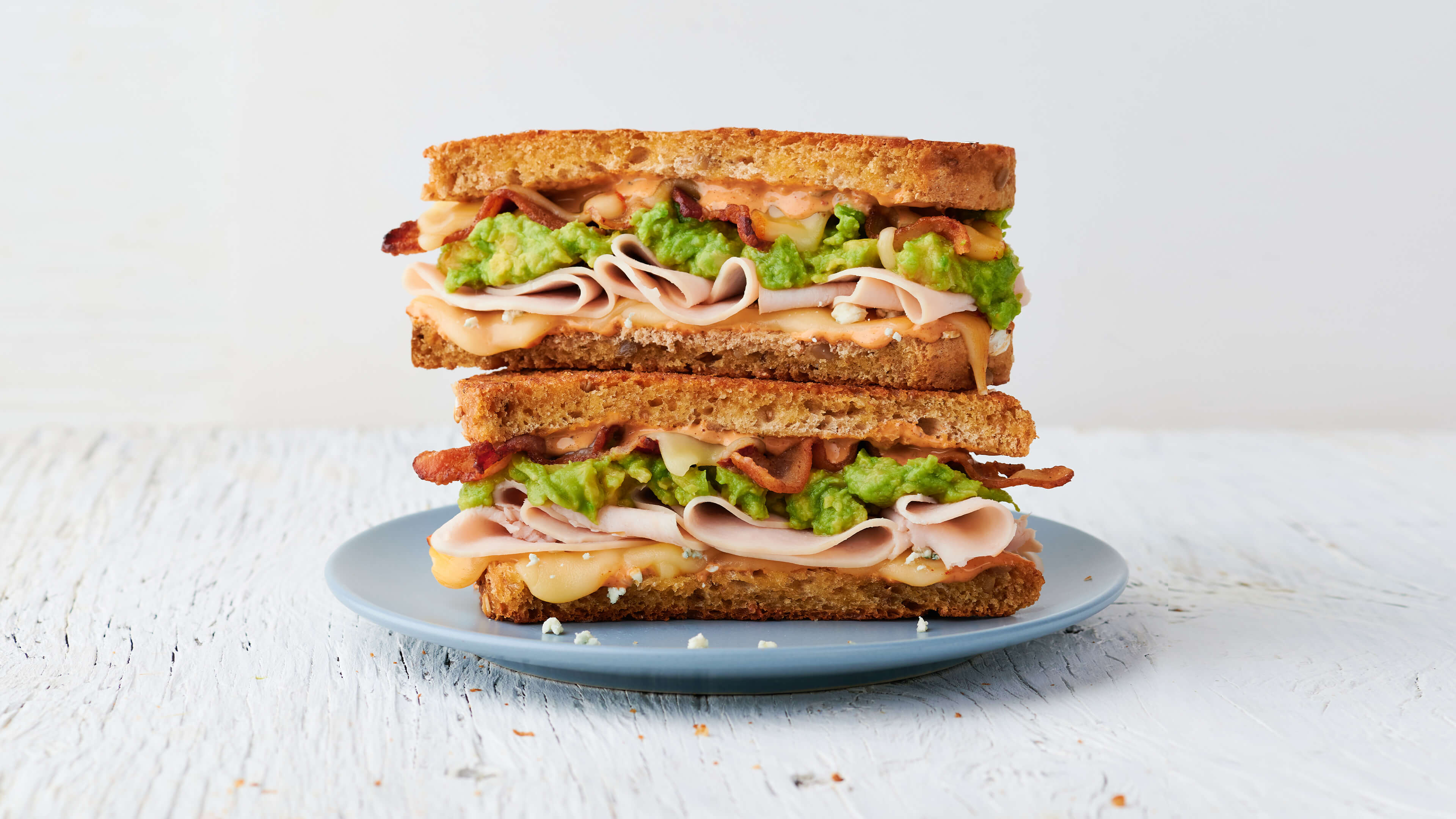 Roasted turkey, bacon, muenster cheese, blue cheese crumbles, avocado spread & Society Sauce on choice of bread
