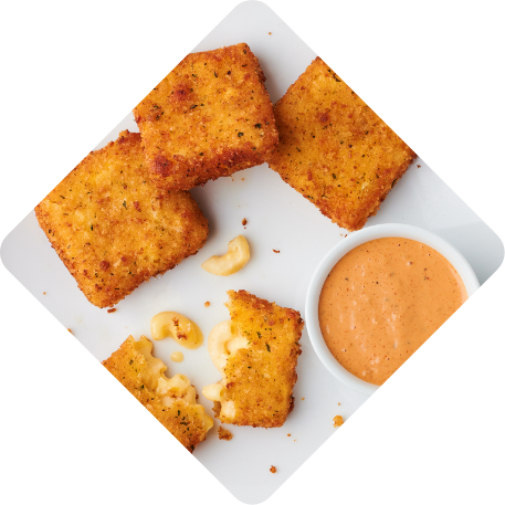 Toasty Mac Bites - Golden-fried mac & cheese bites served with Society Sauce for dunking