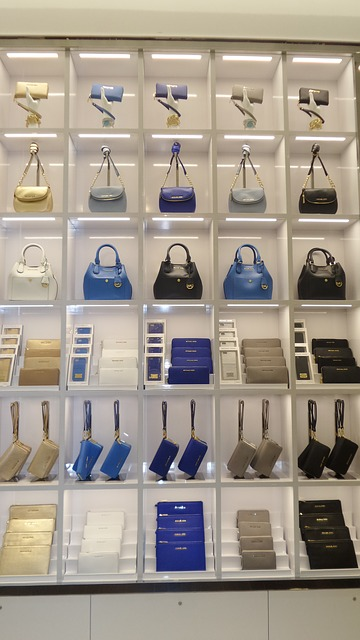 Wall of Michael Kors handbags