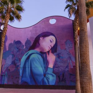 Mural of a young woman touching her hair