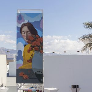 Mural of a woman next to a vase of flowers