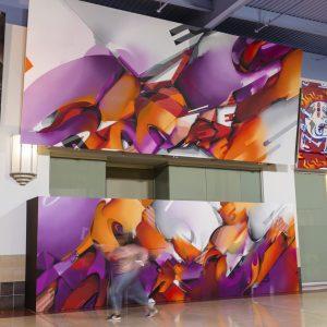 Purple and orange graffiti-style abstract murals