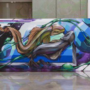 Mural of two graffiti-style fish
