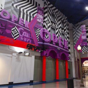 Black, red, and purple graffiti-style mural
