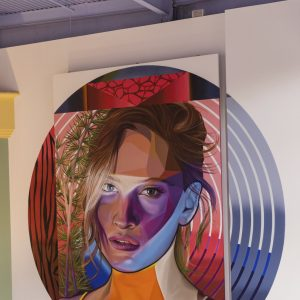 Mural of a woman's face with colorful shading in a circle
