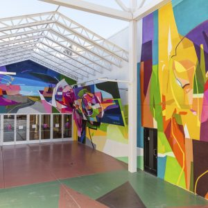 Abstract colorful graffiti-style murals inside Prizm Outlets