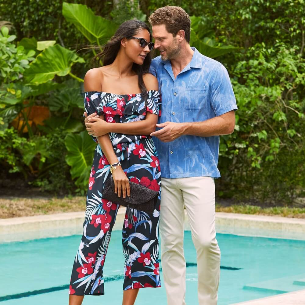 Young couple wearing Tommy Bahama apparel next to a pool