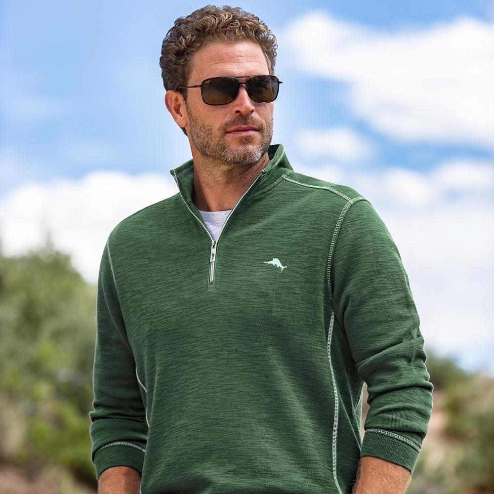 male model wearing hunter green half zip up