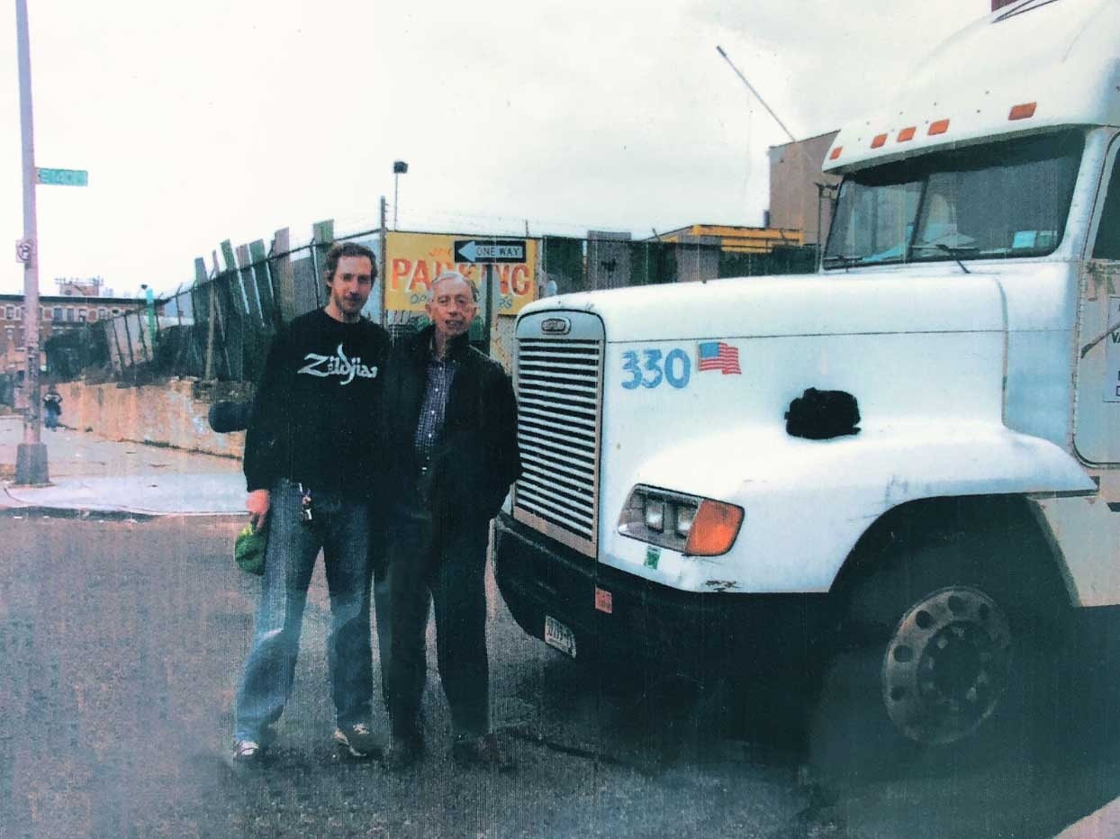 Alex Alpert with his father in front of a moving truck, starting their moving business