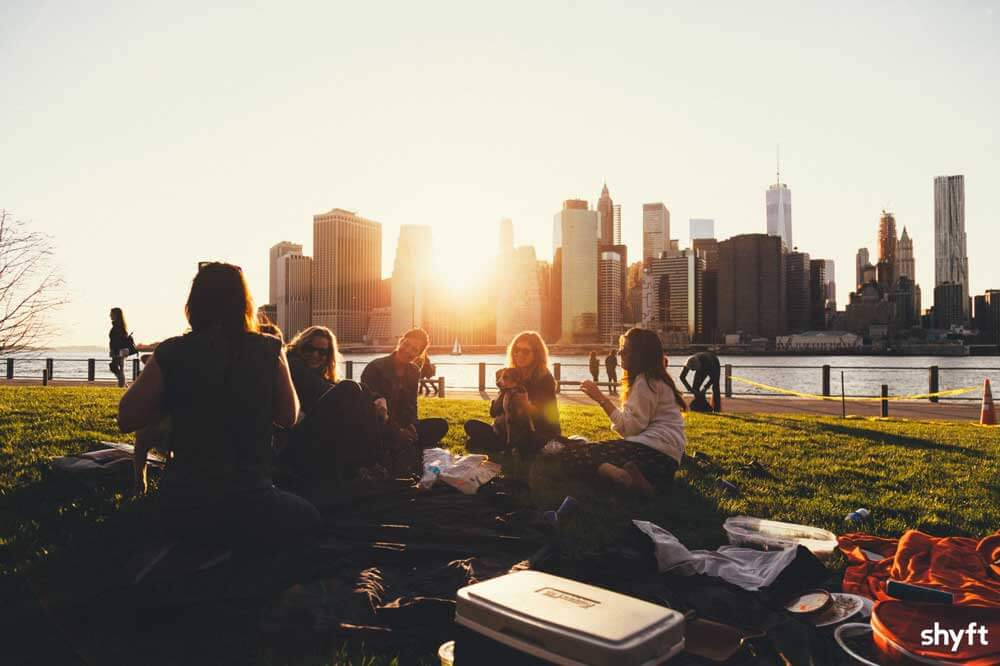 Students socializing and picnicking after completing their move to a new city for their studies