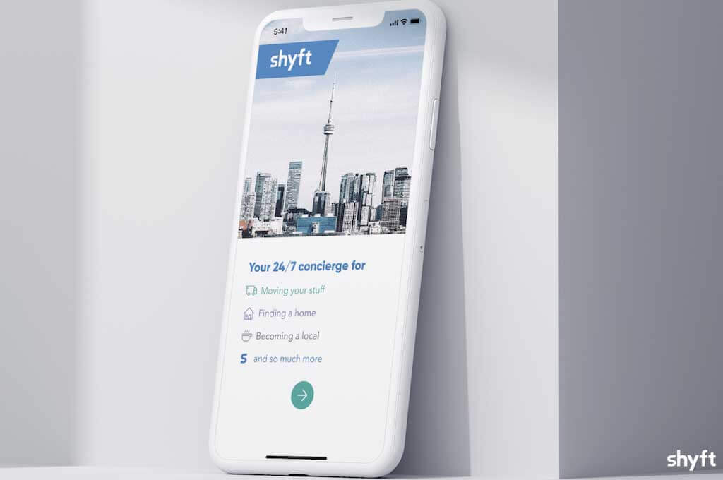 A mobile phone showing Shyft's moving app interface with personal concierge available 24/7 for clients