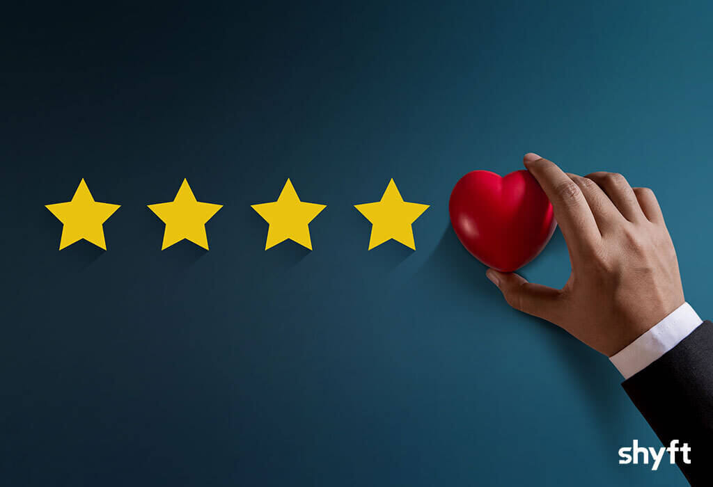 Rating stars and a hand placing heart in a place of fifth star