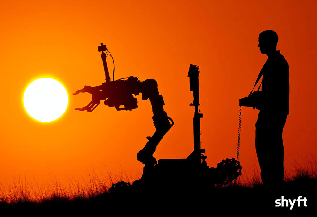 A man with robot in sunset