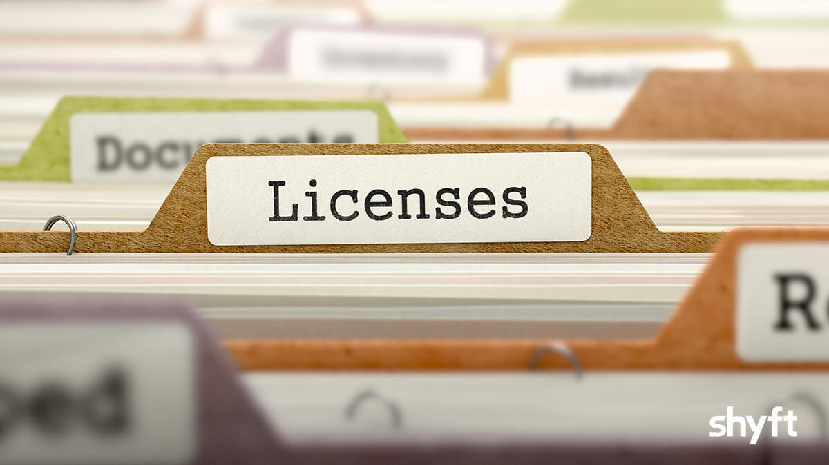 Close up of different colored files with the word: Licenses in the center