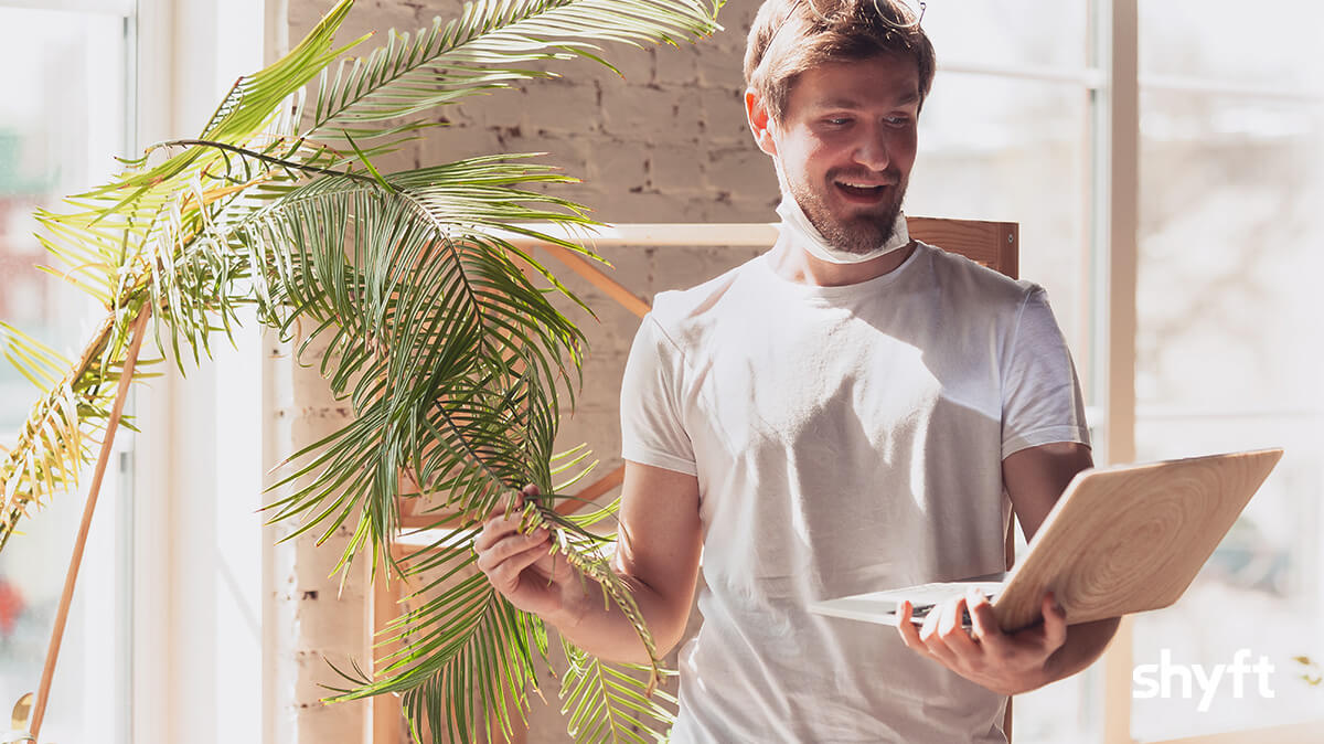 a man inside his home showing his plant to relocation specialist for his inventory estimate