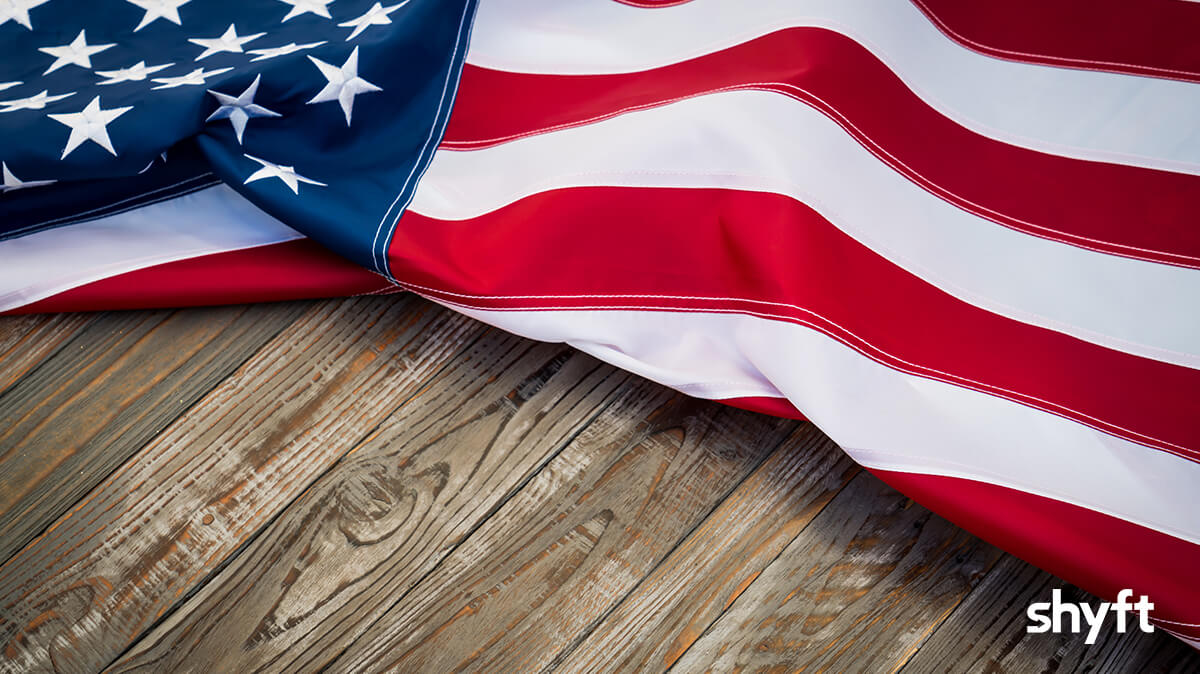 United States flag laying on a wooden table