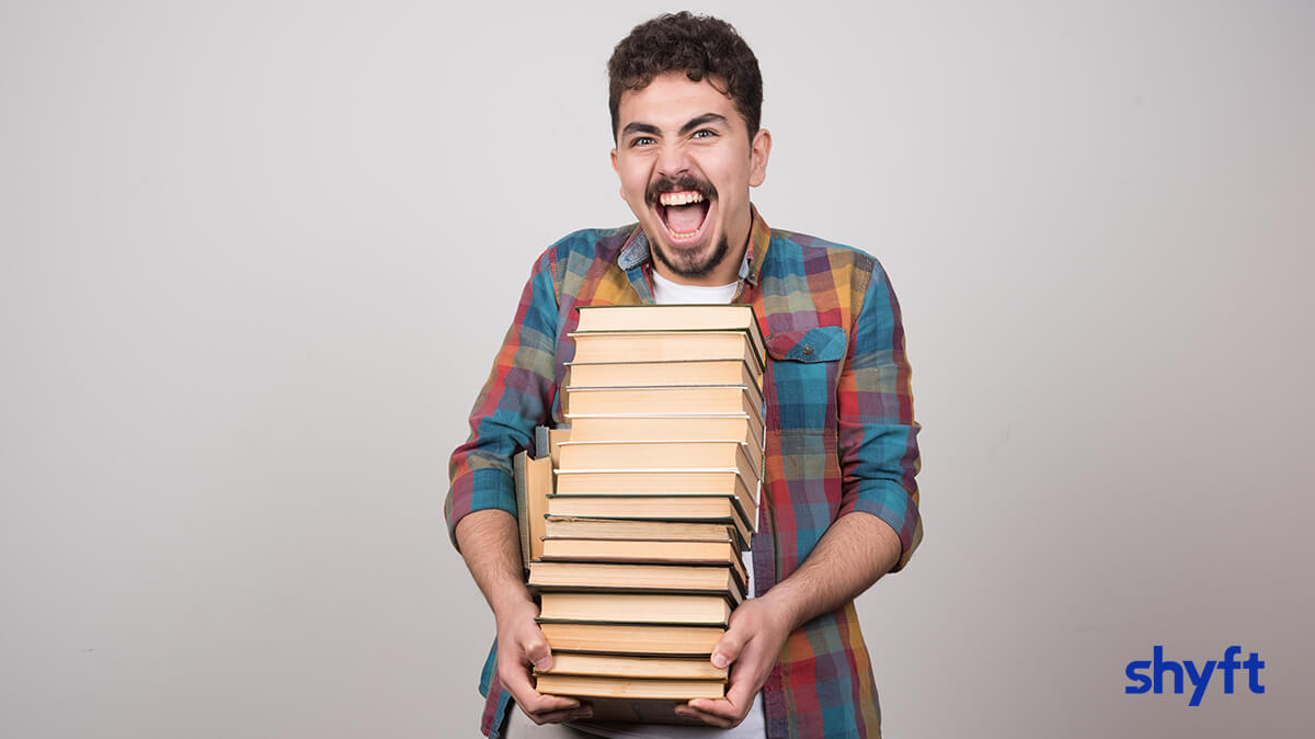 A man carrying heavy books to full service storage