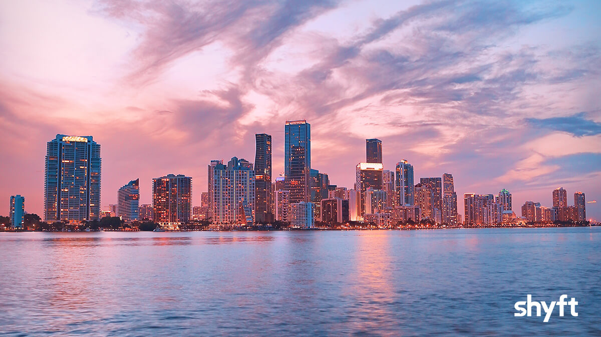 Skyline of Miami at sea level, with buildings in the background and sea in the foreground