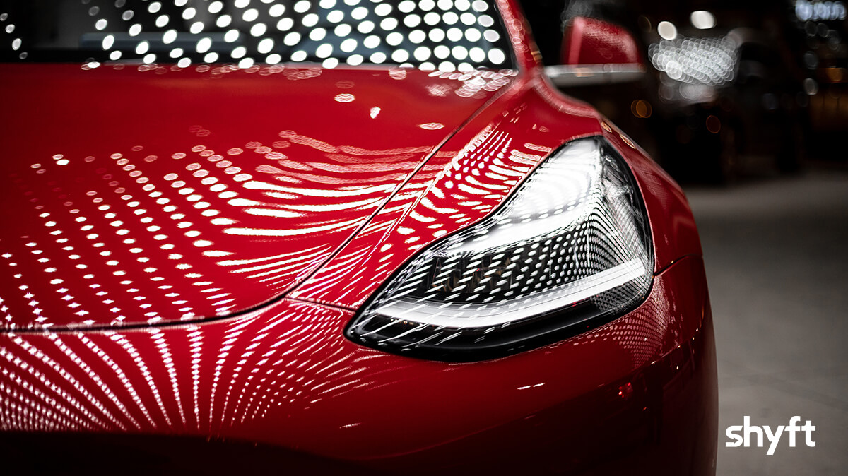 A red car with light patterns on it during a car fair