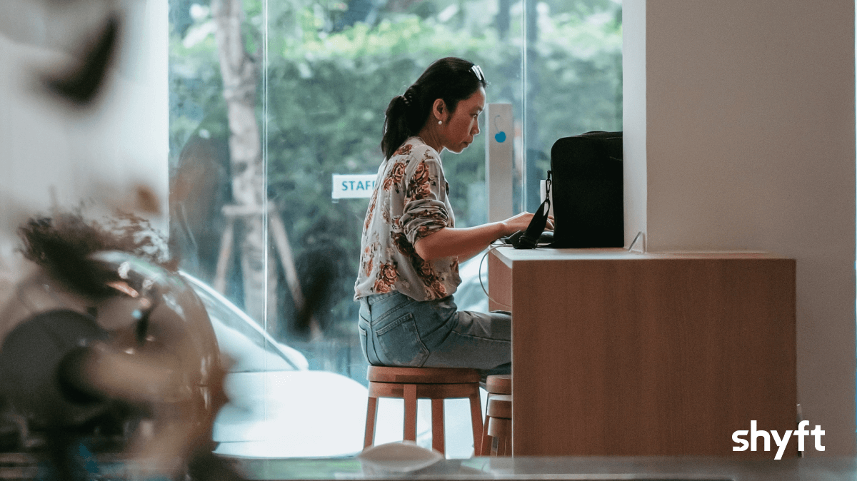 A lady working remotely in a cafe