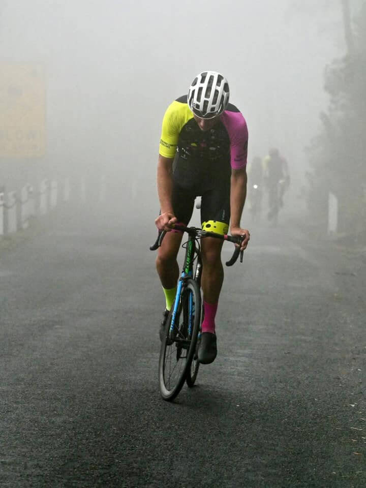 Person riding in mist