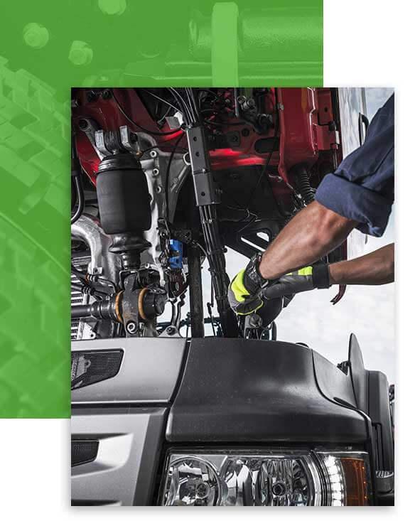 Certified mechanic fixing truck