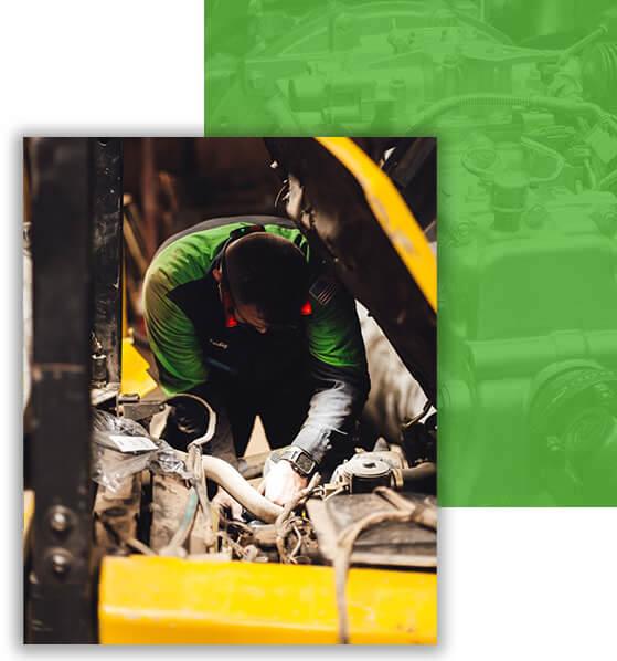 Truck technician fixing air intake