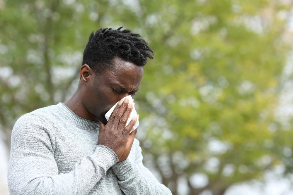 man having allergies