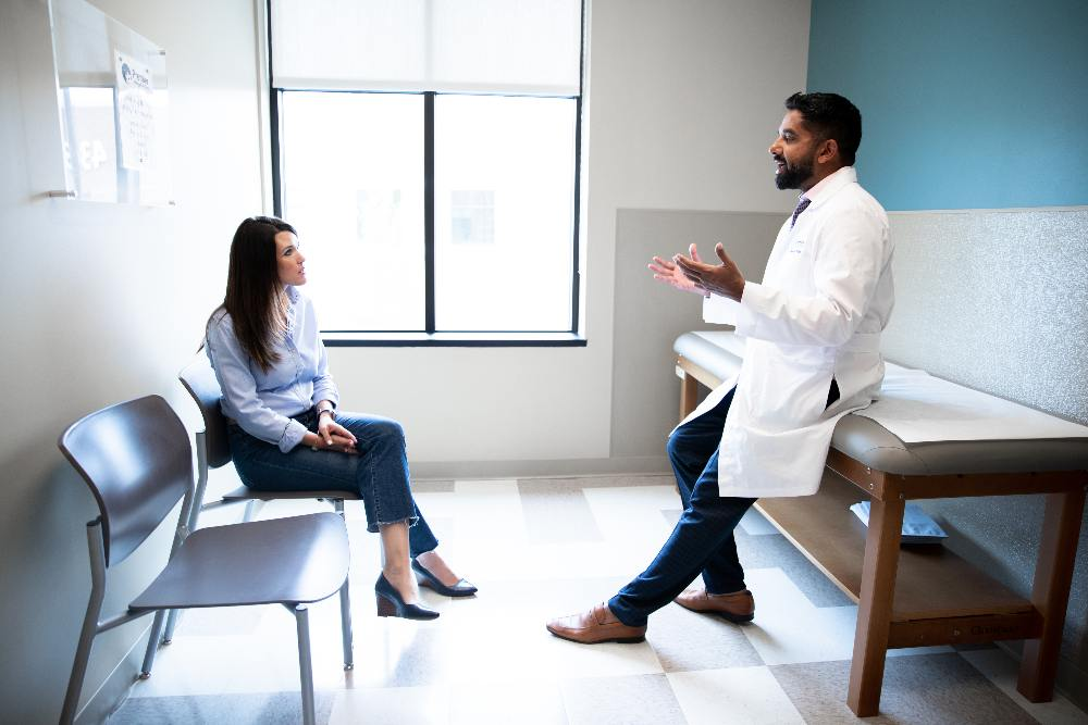 Dr. Shah talking to patient