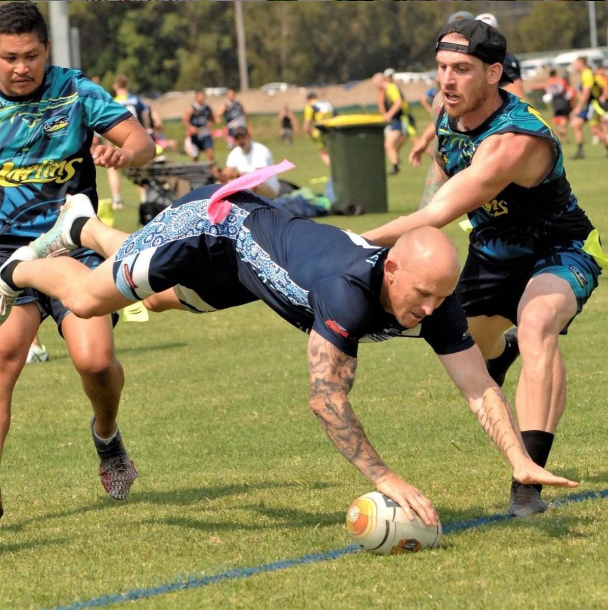 3 men playing football