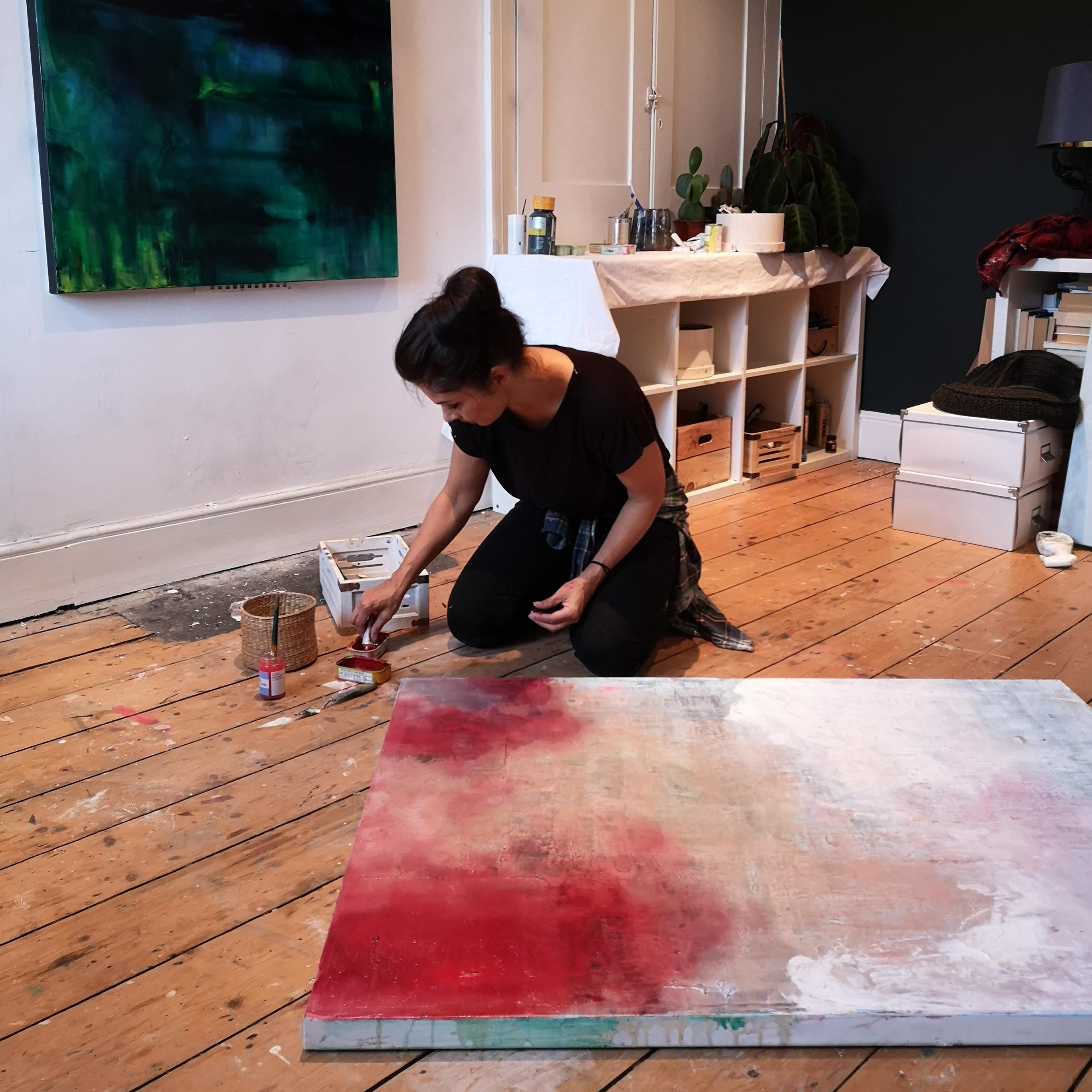 Artist Julia Swaby creating a painting