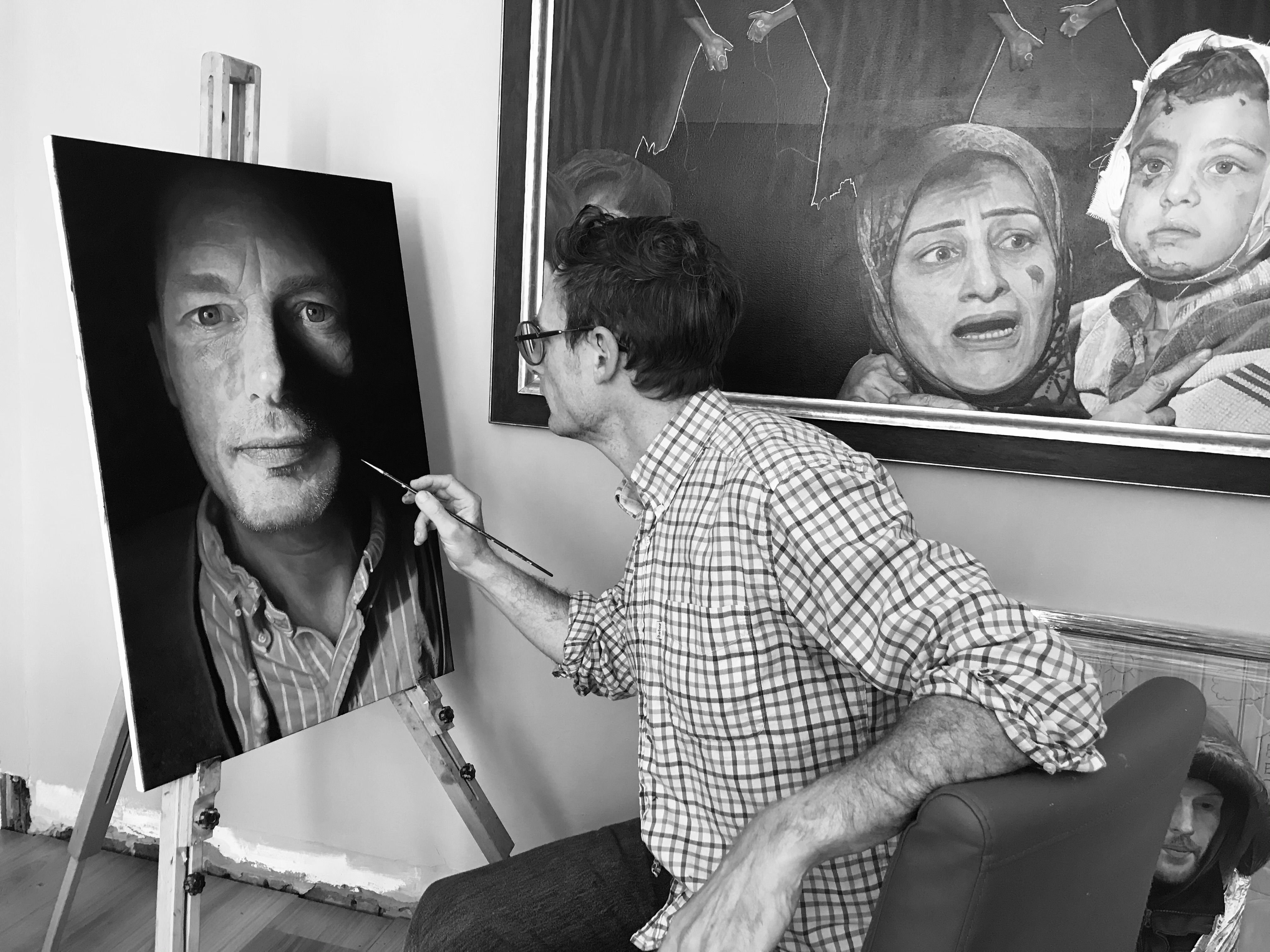 Artist James Earley painting a potrtait