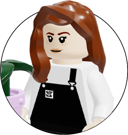 Lego figure of the graphic designer.   Female figure with brown hair and holding a plant pot