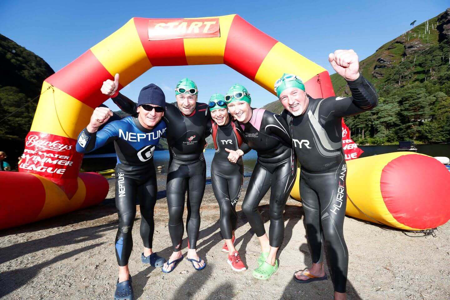 Open water swimmers celebrating after completing their races event with Open Water Swimmer