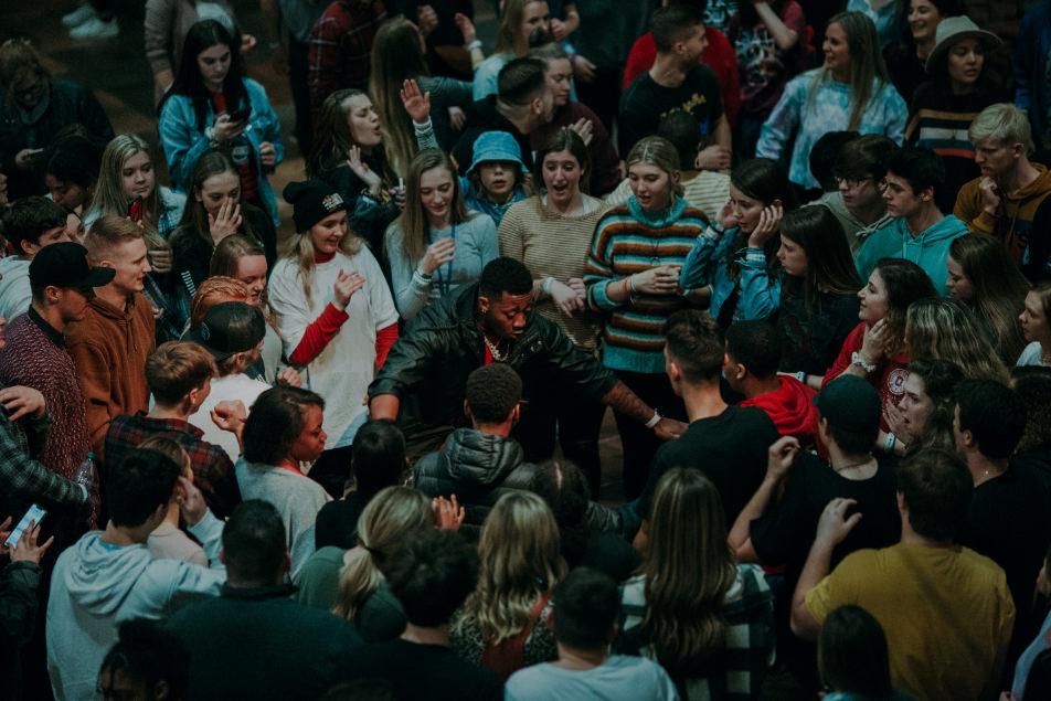 People gathered around a dancer