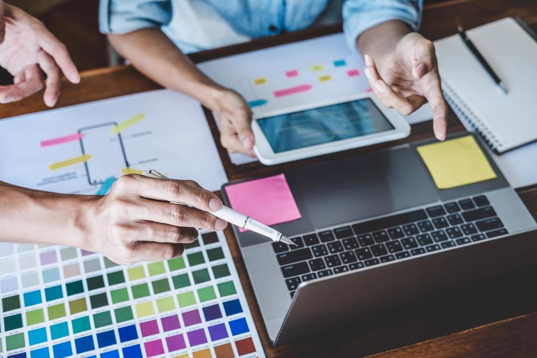 Creative team designing website